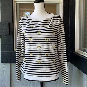 Black & white striped top w/ gold lip embroidery.